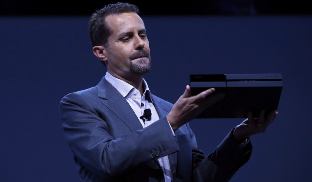 LOS ANGELES, CA - JUNE 10:  Andrew House, president and group CEO Sony Computer Entertainment Inc., holds up a Playstation 4 at the Sony Playstation E3 2013 press conference on June 10, 2013 in Los Angeles, California. Thousands are expected to attend the annual three-day convention to see the latest games and announcements from the gaming industry. (Photo by Eric Thayer/Getty Images)